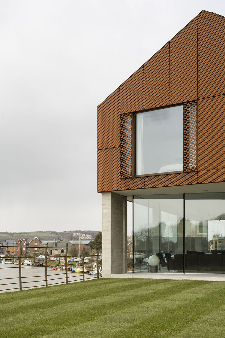 Two-story home in England with a Cor-Ten rainscreen facade