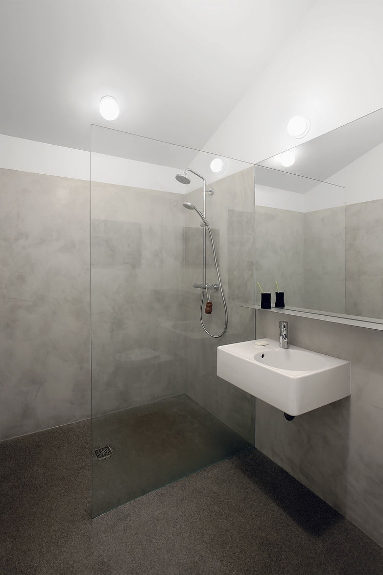 Minimalist cement plaster bathroom.