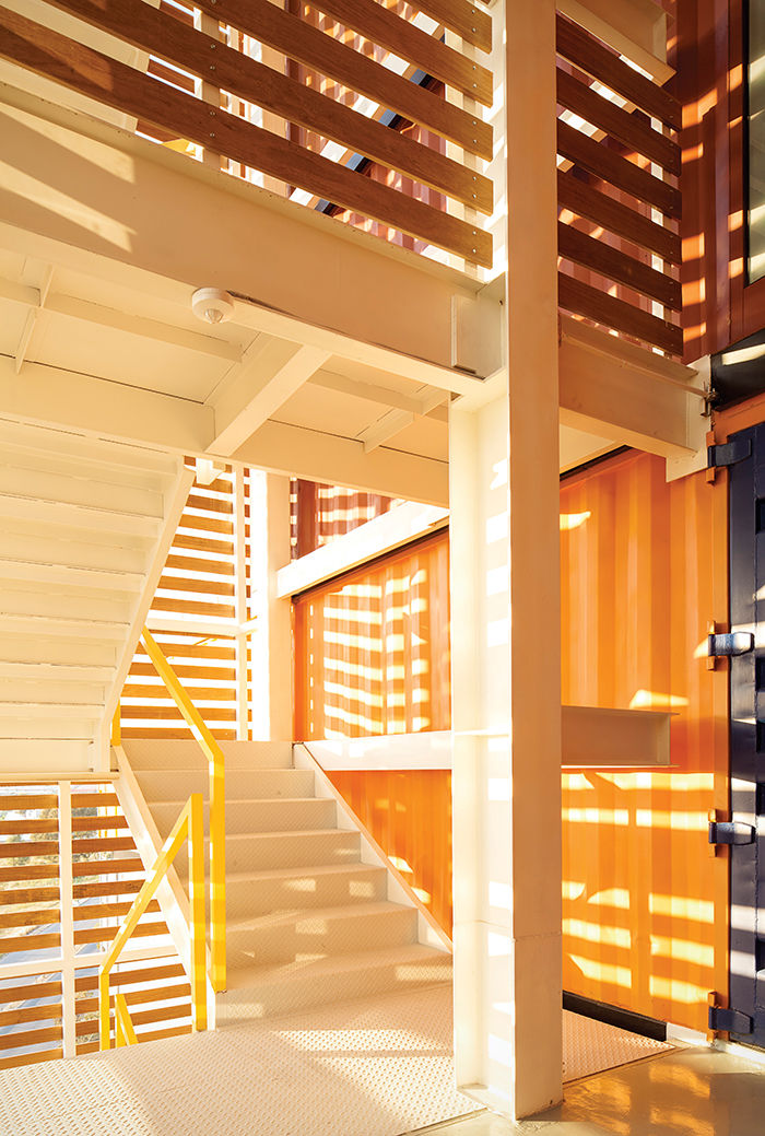 Prefab housing unit in Mexico made of shipping containers with wood staircase