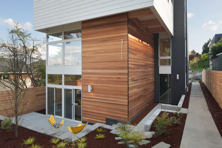 Stained Cedar and Benjamin Moore Glacier White facade of Seattle home by JW Architects