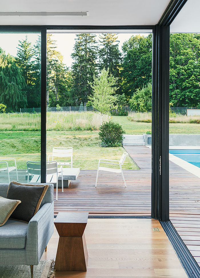 Boston prefab guest home and pool has aluminum sliding glass door system by Solar Innovations