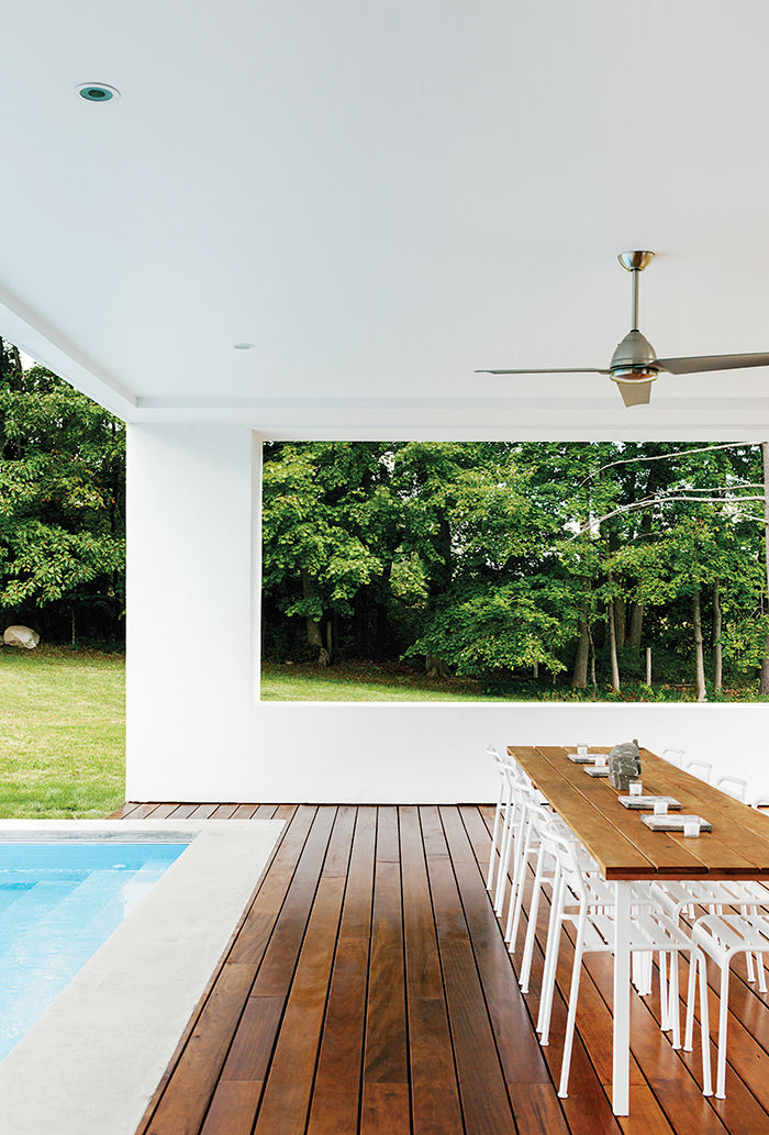 Boston prefab guest home and pool deck made of garapa has ikea chairs and Minka-Aire fan
