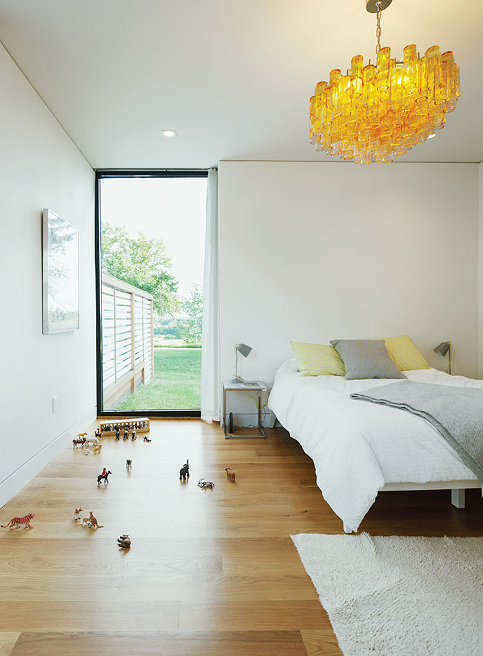 Boston prefab guest home and pool guest bedroom with west elm bed, murano glass chandelier, and flokati rug