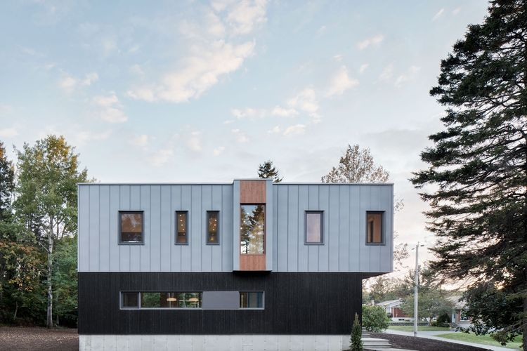 Brick, wood, and steel facade of Quebec renovation by Naturehumaine.