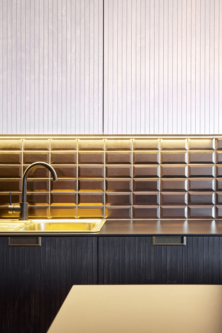 Diffusion Ceramique tiles and countertop from Fundermax in Prague kitchen renovation.