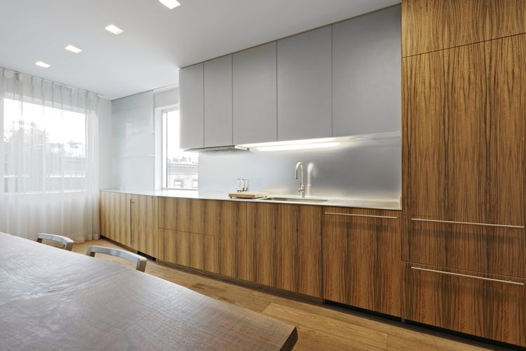 Soho penthouse with a custom wood kitchen cabinets