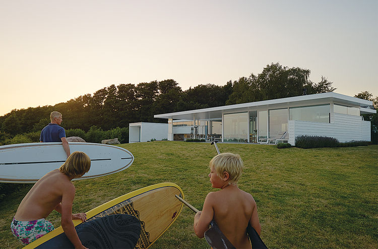 Modern Swedish family dream getaway with glass windows on the facade