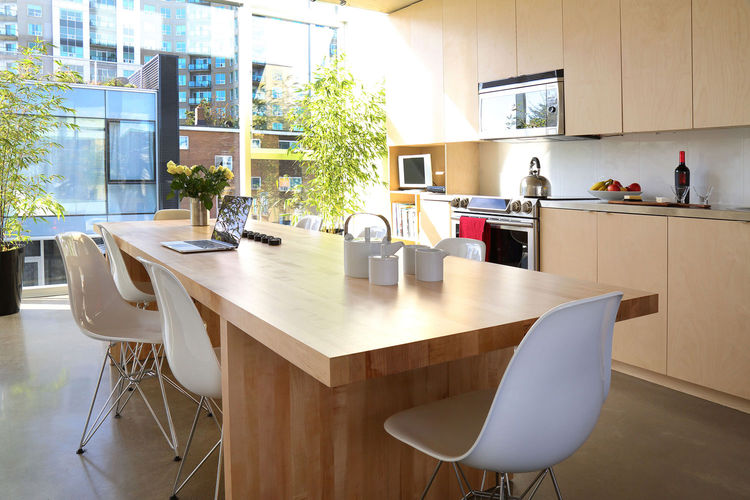 A modern eat-in kitchen with a birch butcher block table