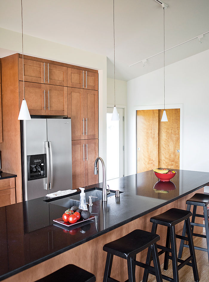 Modular, Prefab home of the grandson of Frank Llloyd Wright kitchen island with Caeserstone countertop