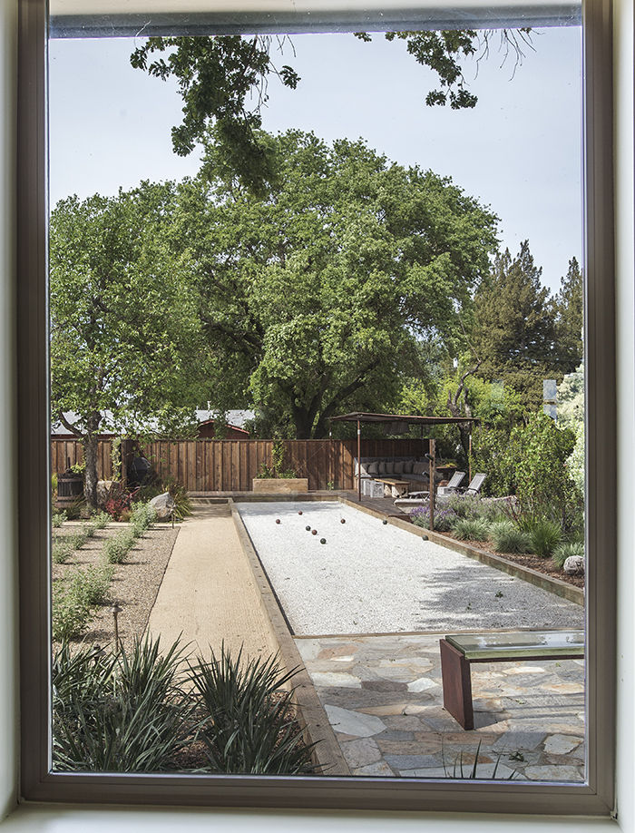Bocce court and landscaping at the Stillwater Dwellings prefab in Napa