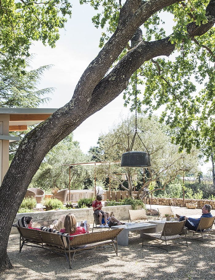 Outdoor living area of the Stillwater Dwellings prefab in Napa
