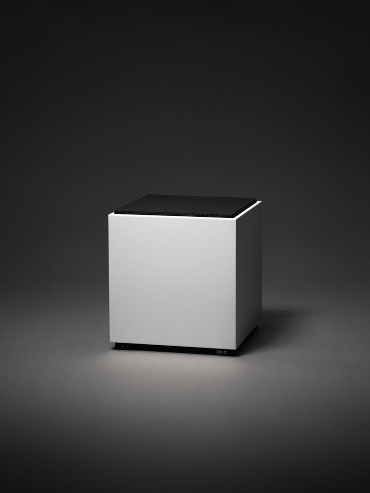 Minimalist cube speaker with black grille