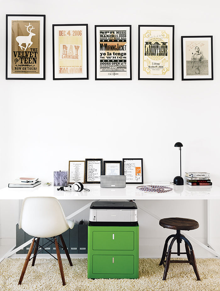 Modern Texan addition and renovation with blu dot table and vintage posters in the office