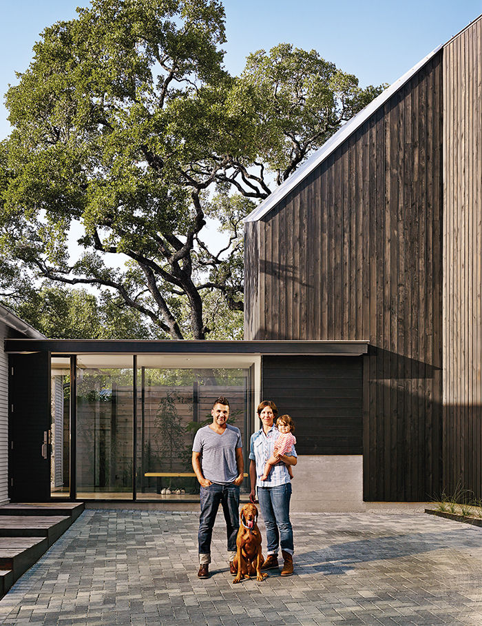 Modern Texan addition and renovation with eco Priora pavestones that collect rain water runoff