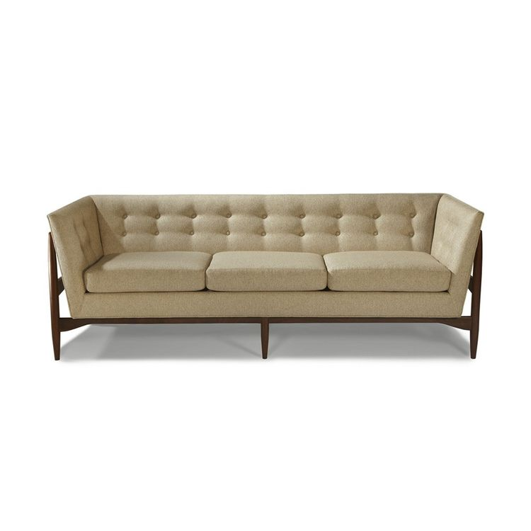 Midcentury sofa with exposed wood frame