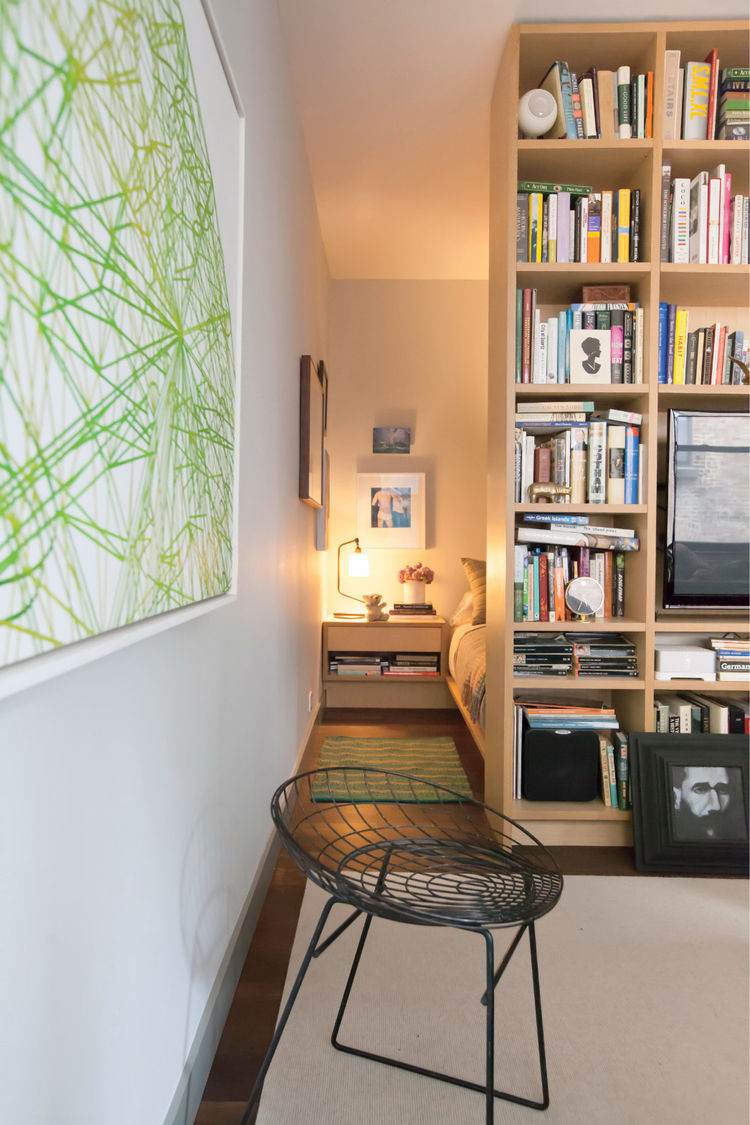 Small modern New York City studio with white oak bookcase divider