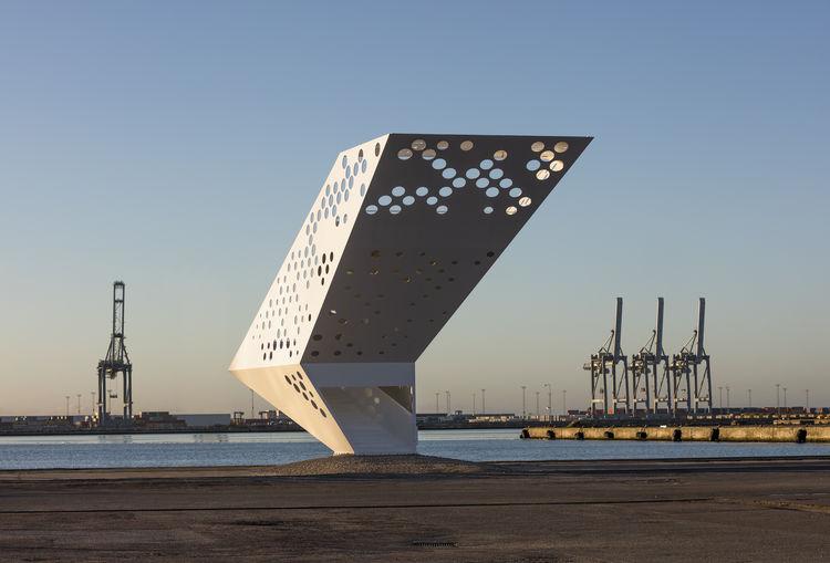 Sculptural steel viewing tower in Arhaus harbor.