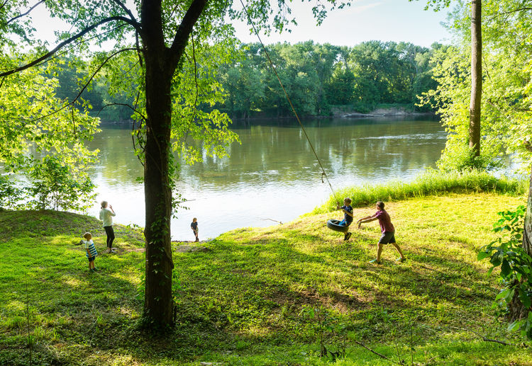 A family plays along the Virginia riverside's long narrow plot.