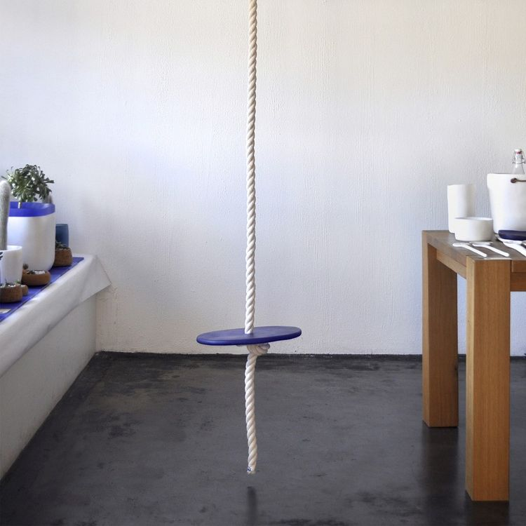 Cheerful rope tree swing with blue resin seat