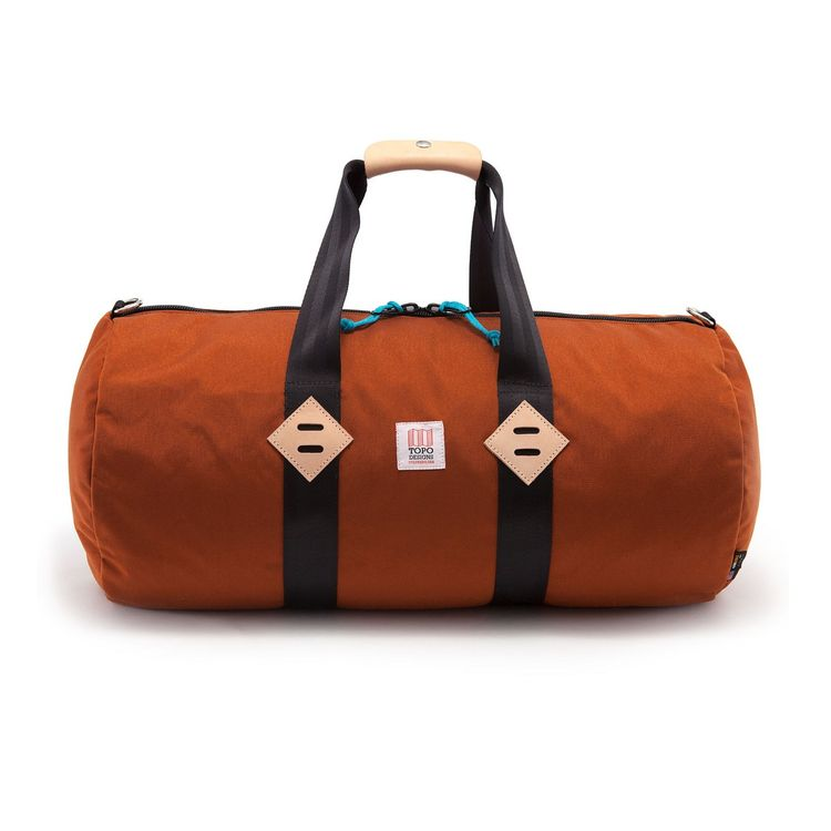 Classic duffle bag in clay orange with turquoise pulls
