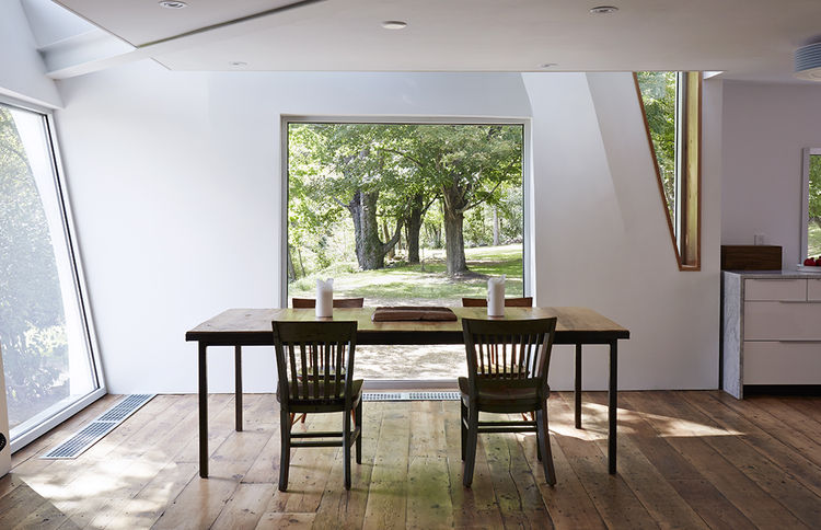 Dining area with windows n the new, modern addition
