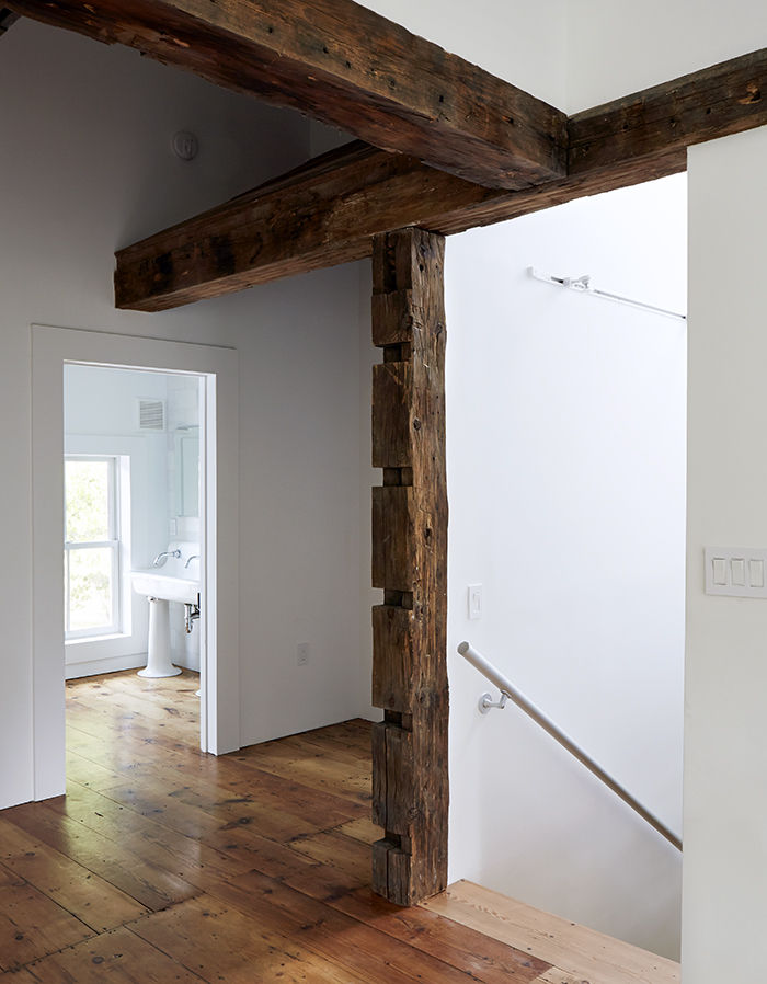 Rough exposed wood beams in the renovated Twist Farmhouse