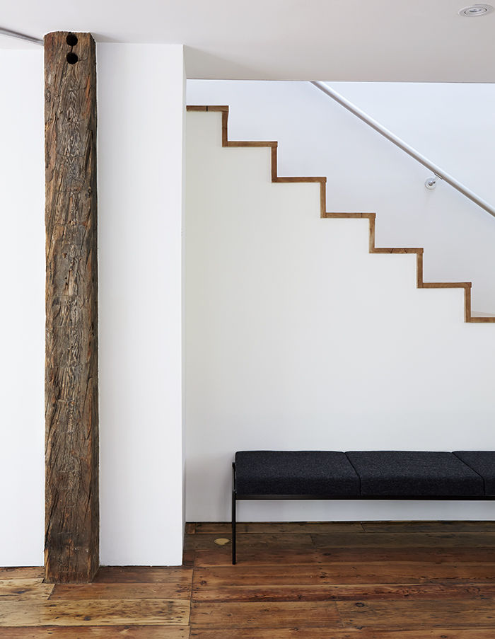 Modern staircase in the renovated Twist Farmhouse