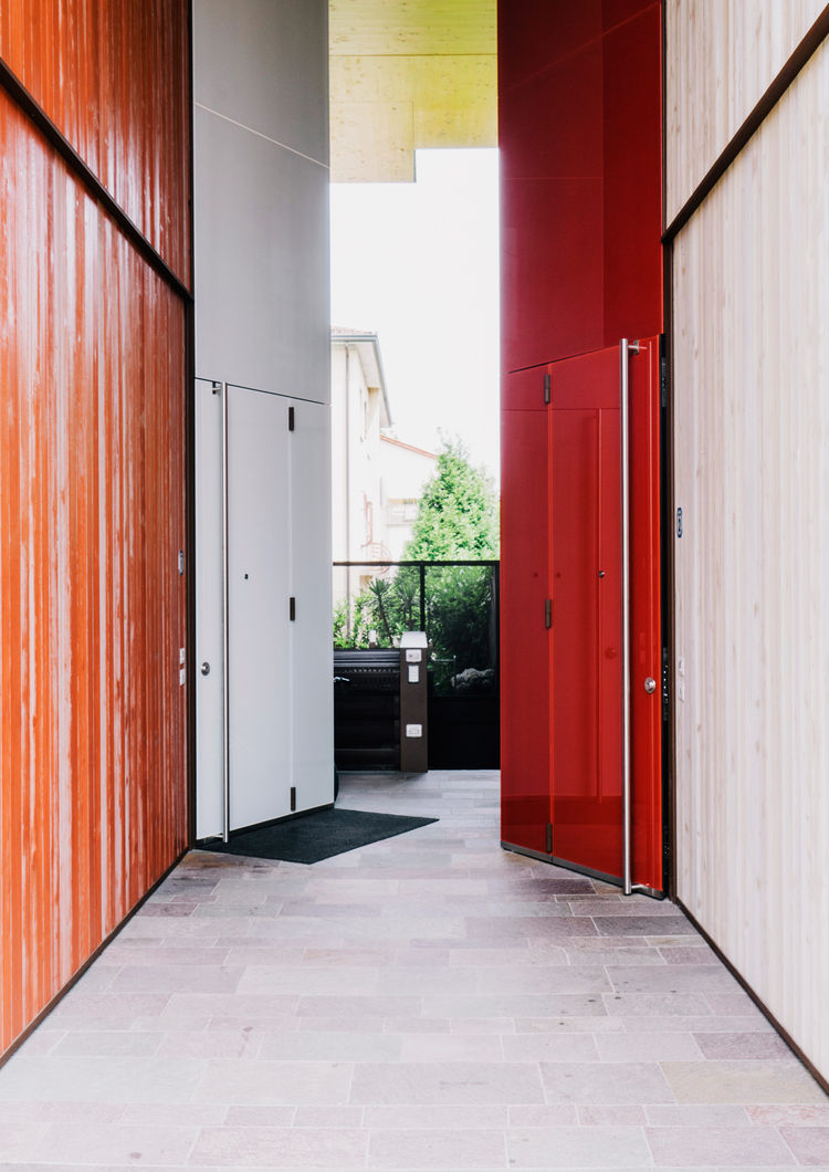 Custom doors designed for the entrances in contrasting light and dark light finishes.