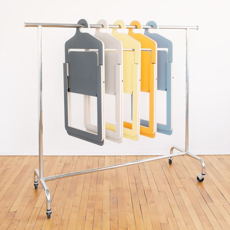 Quirky folding chair with hanging mechanism
