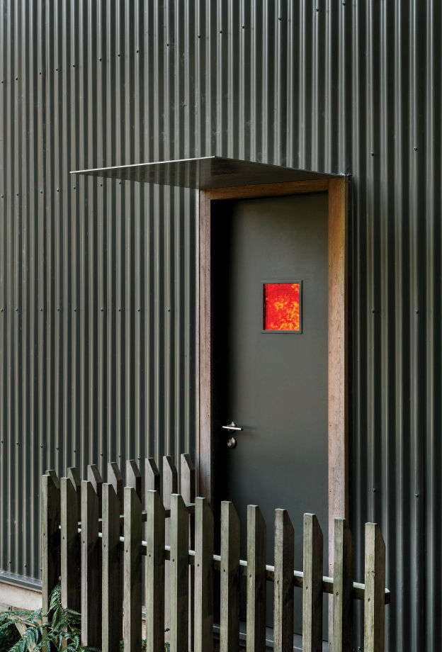 Modern small space in New Zealand with corrugate metal cladding