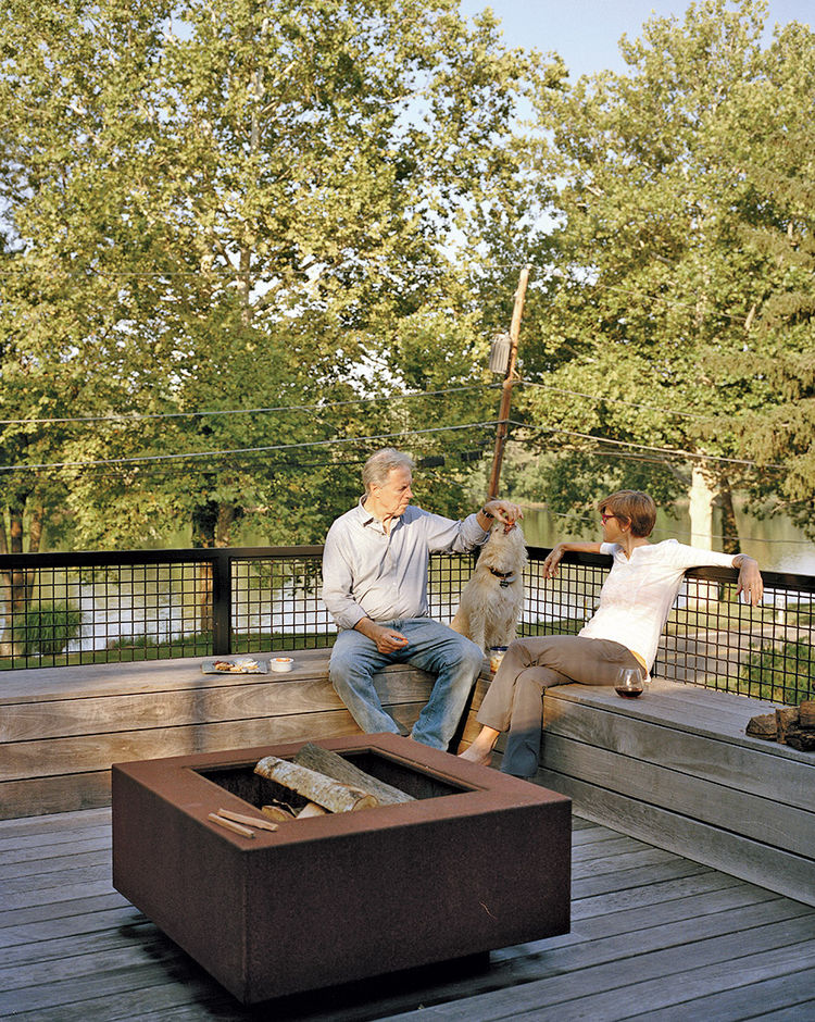 Cor-Ten steel fire pit on the second-floor deck of shipping container home in Pennsylvania off the Delaware River