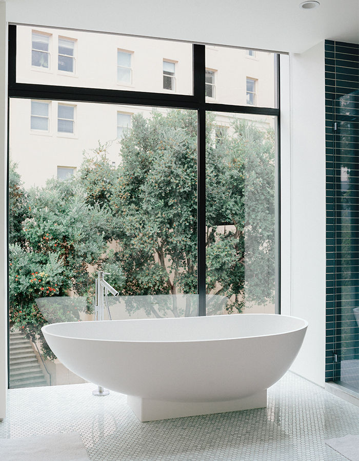 Modern renovation in San Francisco with heath ceramics tiles, Agape tub and retractable shades in the master bathroom.