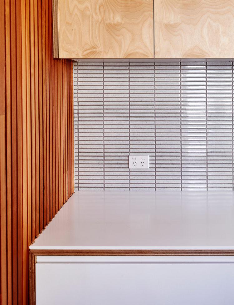 Cedar slats contrast with a tile backsplash