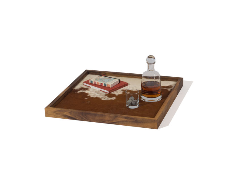 Distinctive serving tray with cowhide surface
