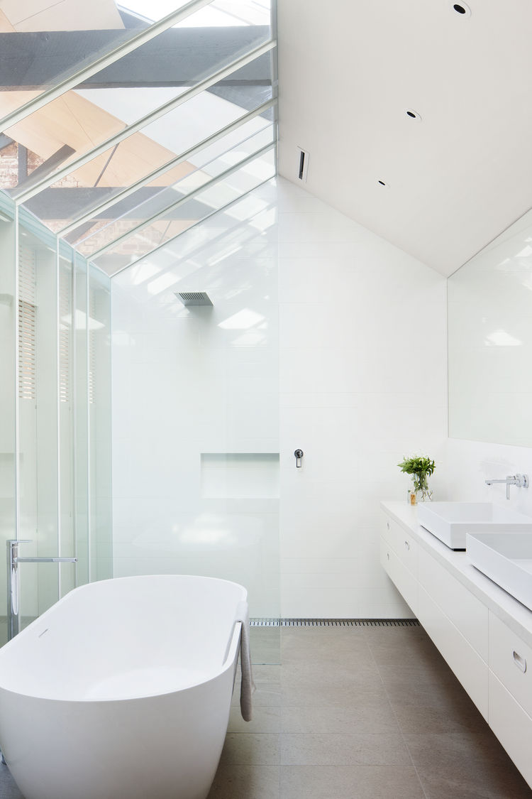 Bathroom with skylight in renovated warehouse.