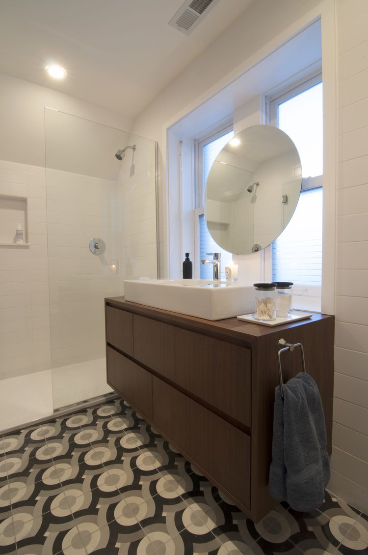 Custom patterned tiles in Chicago renovation's bathroom.