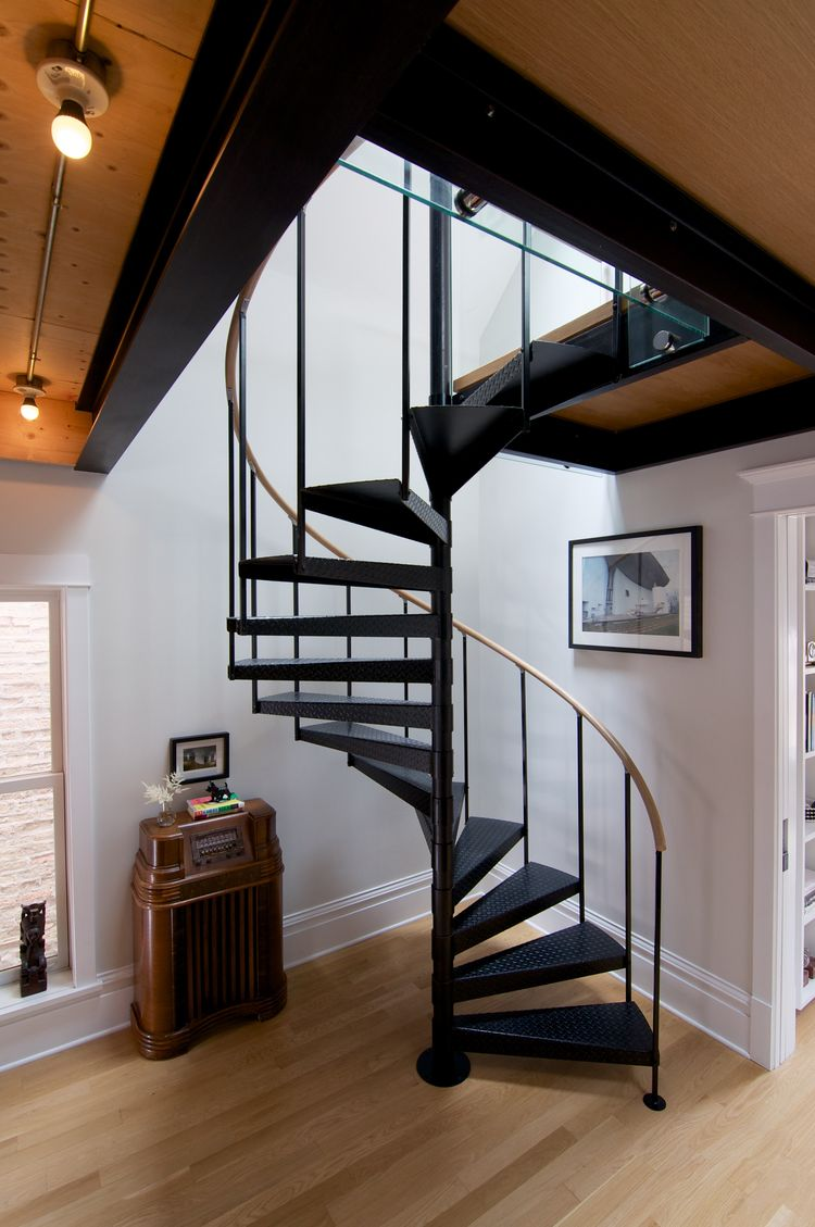 Custom white oak handrail and floors in Chicago home.