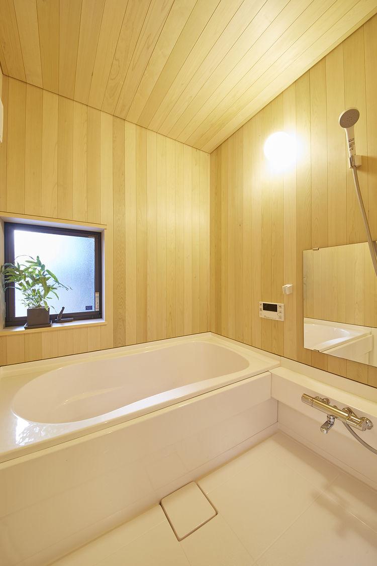Toto bathtub in sauna-like Japanese bathroom.