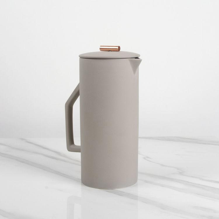 Ceramic coffee press with copper pull
