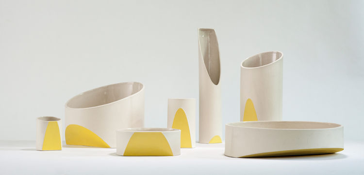 Seven geometric sculptures strategically placed to emphasize their form.