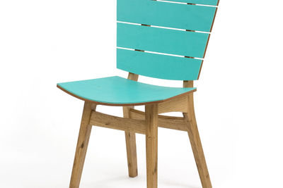 The Havaianas dining chair is the result of Motta's recent collaboration with the popular Brazilian flip-flop company, which commissioned the chair, in freijó wood covered in the same grippy rubber used for the shoes, with a rubber handle in the back. It