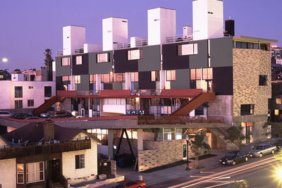 """Along a busy street in San Diego's Little Italy neighborhood stands the mixed-use building in which architect Nathan Lee Colkitt and a diverse array of tenants inhabit their live/work spaces. """"It's hard to describe—it's really funky,"""" says Colkitt of the"""