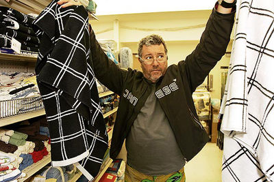 Hollywood, CA - December 04, 2008: Designer Philippe Starck shops with his wife Jasmine Starck and daughter Ara at a Big Lots store in Hollywood. Philippe Starck is a designer of iconic furniture, products and interiors. (Al Seib  / Los Angeles Times)