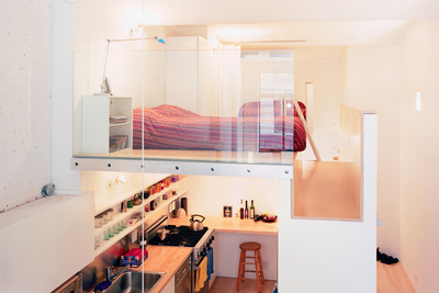 "The volume that both incorporates the single closet (accessible from the hallway) and the refrigerator (which opens into the kitchen) and serves as the bedroom floor is, says Kyu Sung Woo, ""where everything comes together."""