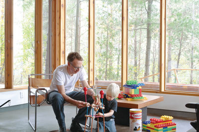 Modern playroom with tall windows