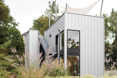 Modern weekend home with Pac-Clad metal cladding on roof