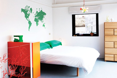 Modern bedroom with world map wall decal