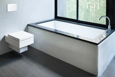 modern bathroom with white penny tiles