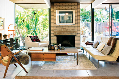 Living room of a mid-century Eichler outfitted with vintage furniture