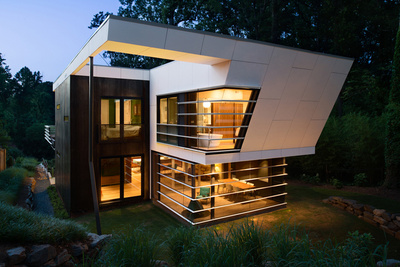 modern house with concrete and cor-ten steel rainscreen